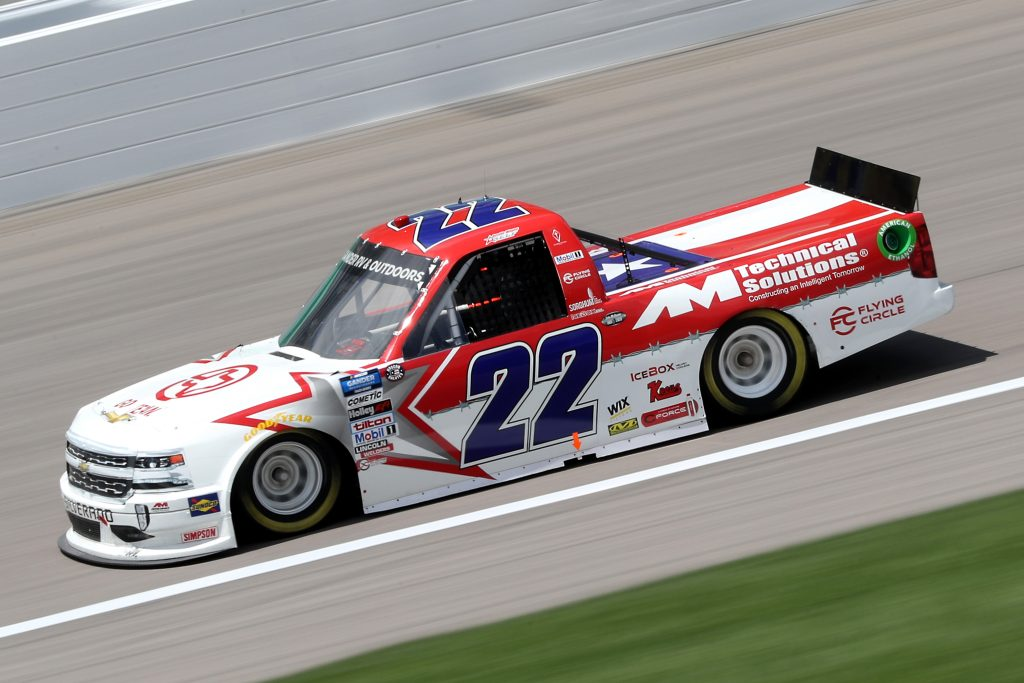 KANSAS CITY, KANSAS - JULY 25: Austin Wayne Self, driver of the #22 GO TEXAN/AM Technical Solutions Chevrolet, drives during the NASCAR Gander RV & Outdoors Truck Series e.p.t 200 at Kansas Speedway on July 25, 2020 in Kansas City, Kansas. (Photo by Jamie Squire/Getty Images) | Getty Images