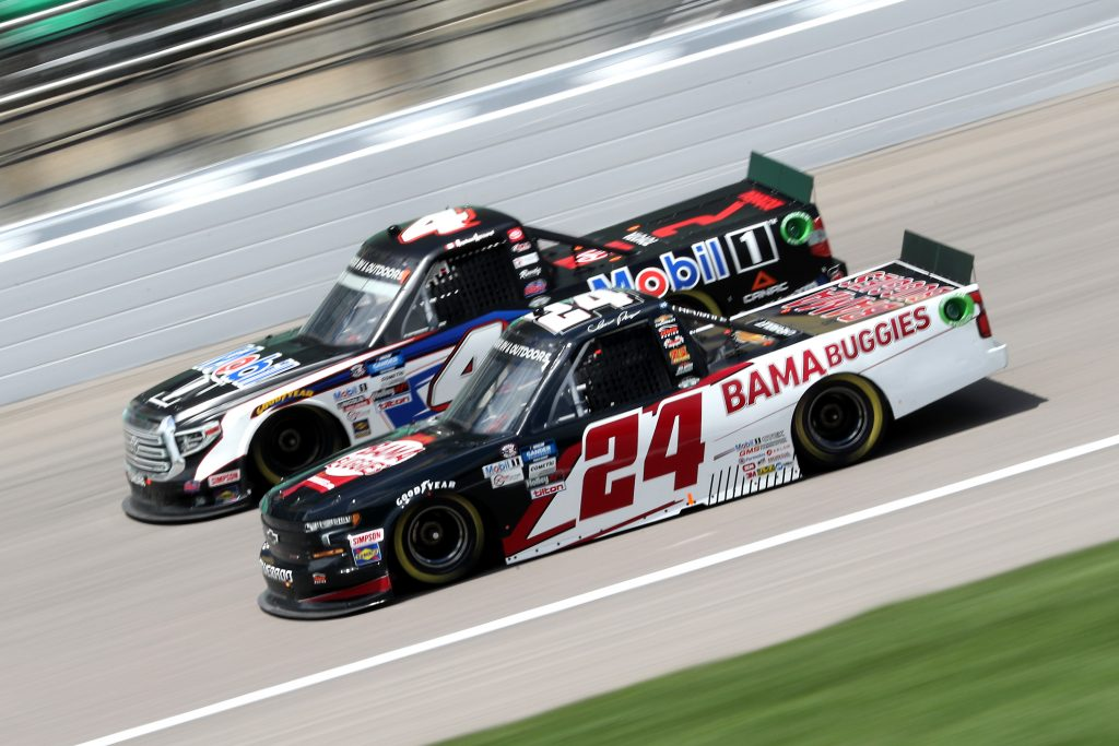 KANSAS CITY, KANSAS - JULY 25: Chase Purdy, driver of the #24 BAMABUGGIES.com Chevrolet, races Raphael Lessard, driver of the #4 Mobil 1 Toyota, during the NASCAR Gander RV & Outdoors Truck Series e.p.t 200 at Kansas Speedway on July 25, 2020 in Kansas City, Kansas. (Photo by Jamie Squire/Getty Images) | Getty Images