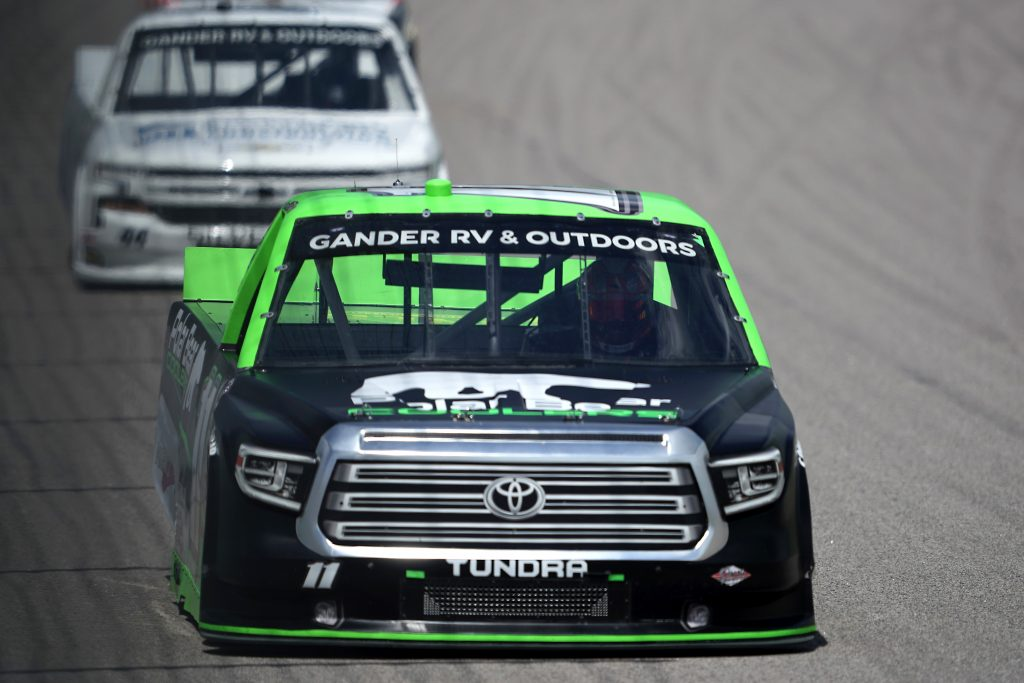 KANSAS CITY, KANSAS - JULY 25: Spencer Davis, driver of the #11 Polar Bear Coolers Toyota, drives during the NASCAR Gander RV & Outdoors Truck Series e.p.t 200 at Kansas Speedway on July 25, 2020 in Kansas City, Kansas. (Photo by Kyle Rivas/Getty Images) | Getty Images