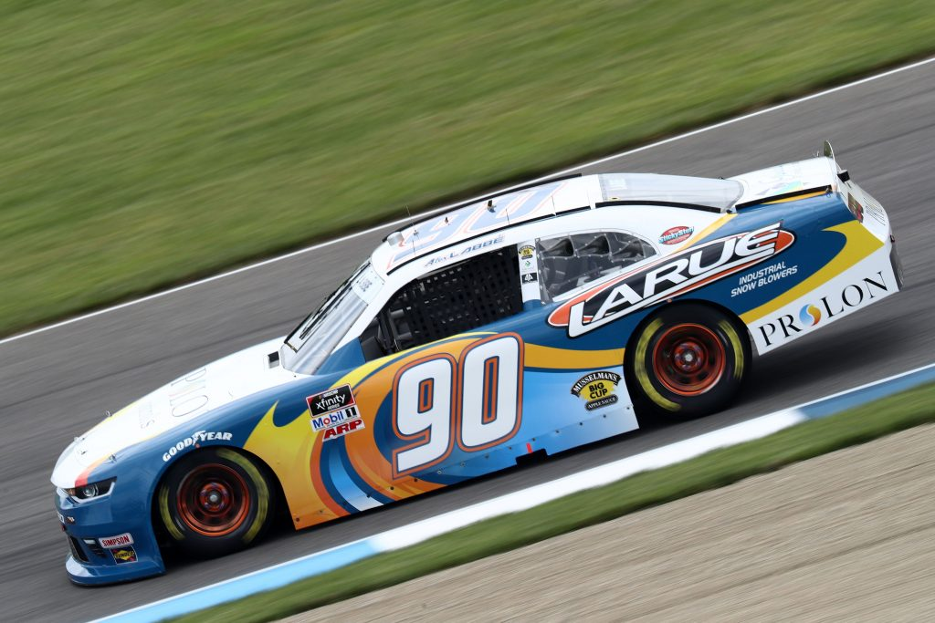 INDIANAPOLIS, INDIANA - JULY 03: Alex Labbe, driver of the #90 Prolon/VRVictroriaVille.com Chevrolet, races during practice for the NASCAR Xfinity Series Pennzoil 150 at the Brickyard at Indianapolis Motor Speedway on July 03, 2020 in Indianapolis, Indiana. (Photo by Jamie Squire/Getty Images) | Getty Images