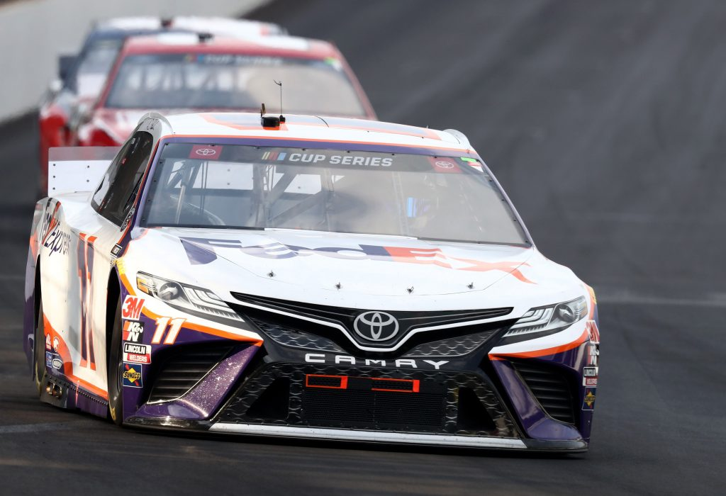 INDIANAPOLIS, INDIANA - JULY 05: Denny Hamlin, driver of the #11 FedEx Express Toyota, drives during the NASCAR Cup Series Big Machine Hand Sanitizer 400 Powered by Big Machine Records at Indianapolis Motor Speedway on July 05, 2020 in Indianapolis, Indiana. (Photo by Jamie Squire/Getty Images) | Getty Images
