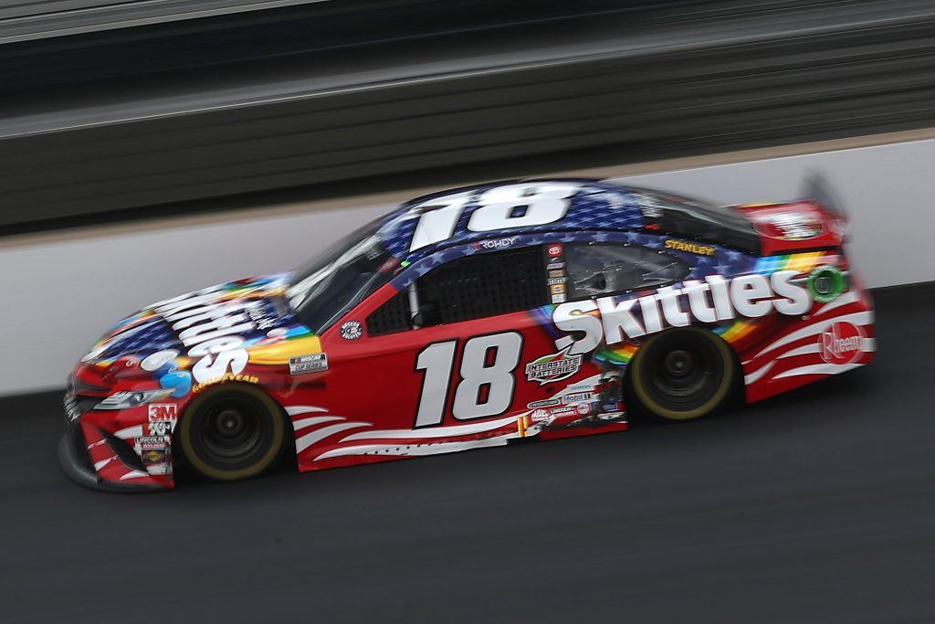 INDIANAPOLIS, INDIANA - JULY 05: Kyle Busch, driver of the #18 Skittles Red White & Blue Toyota, drives during the NASCAR Cup Series Big Machine Hand Sanitizer 400 Powered by Big Machine Records at Indianapolis Motor Speedway on July 05, 2020 in Indianapolis, Indiana. (Photo by Chris Graythen/Getty Images) | Getty Images