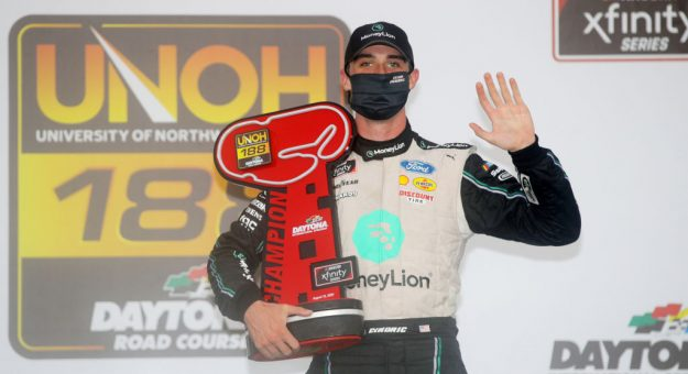 DAYTONA BEACH, FLORIDA - AUGUST 15: Austin Cindric, driver of the #22 MoneyLion Ford, celebrates in Victory Lane after winning the NASCAR Xfinity Series UNOH 188 at Daytona International Speedway on August 15, 2020 in Daytona Beach, Florida. (Photo by Chris Graythen/Getty Images) | Getty Images