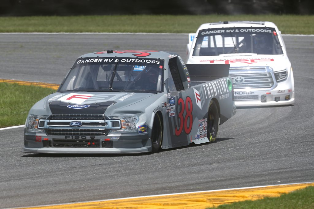 DAYTONA BEACH, FLORIDA - AUGUST 16: Todd Gilliland, driver of the #38 Frontline Enterprises Inc Ford, races Austin Hill, driver of the #16 Toyota Racing Development Toyota, during the NASCAR Gander RV & Outdoors Truck Series Sunoco 159 at Daytona International Speedway on August 16, 2020 in Daytona Beach, Florida. (Photo by Chris Graythen/Getty Images) | Getty Images