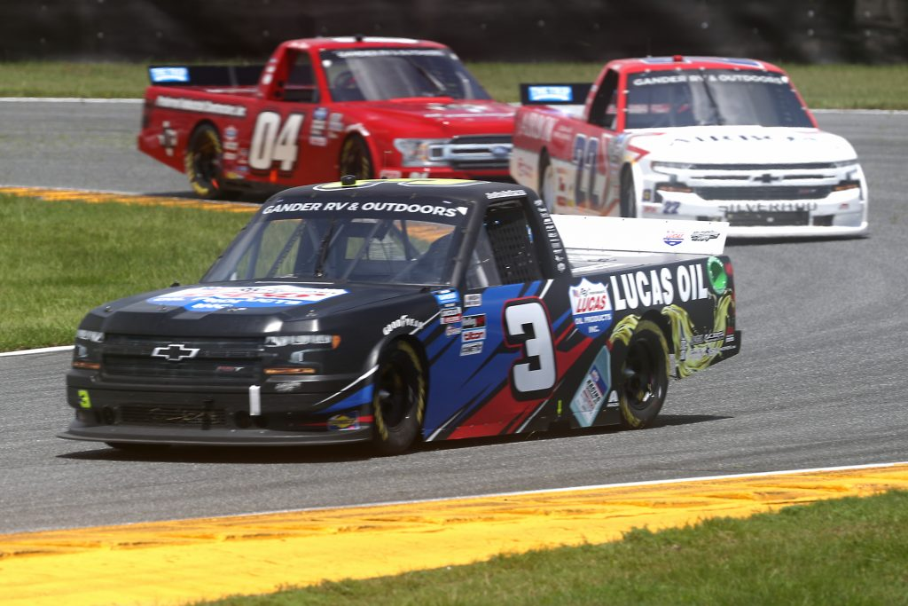 DAYTONA BEACH, FLORIDA - AUGUST 16: Jordan Anderson, driver of the #3 Lucas Oil/Bommarito.com Chevrolet, races Austin Wayne Self, driver of the #22 AIRBOX Air Purifiers Chevrolet, and Cory Roper, driver of the #04 PIC Ford F150 Ford, during the NASCAR Gander RV & Outdoors Truck Series Sunoco 159 at Daytona International Speedway on August 16, 2020 in Daytona Beach, Florida. (Photo by Chris Graythen/Getty Images) | Getty Images