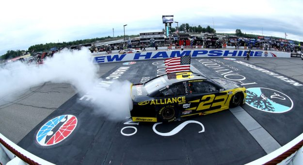 LOUDON, NEW HAMPSHIRE - AUGUST 02: Brad Keselowski, driver of the #2 Western Star/Alliance Parts Ford, celebrates with a burnout after winning the NASCAR Cup Series Foxwoods Resort Casino 301 at New Hampshire Motor Speedway on August 02, 2020 in Loudon, New Hampshire. (Photo by Maddie Meyer/Getty Images) | Getty Images