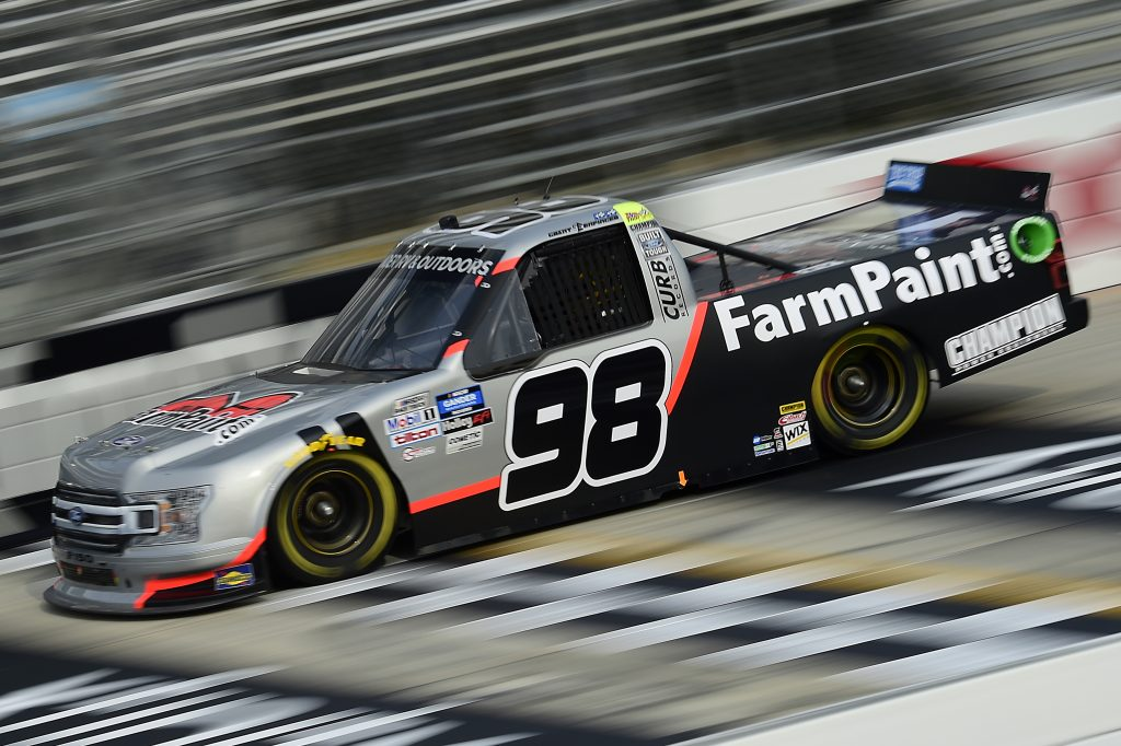 DOVER, DELAWARE - AUGUST 21: Grant Enfinger, driver of the #98 Farm Paint/Curb Records Ford, drives during the NASCAR Gander RV & Outdoors Truck Series KDI Office Technology 200 at Dover International Speedway on August 21, 2020 in Dover, Delaware. (Photo by Jared C. Tilton/Getty Images) | Getty Images