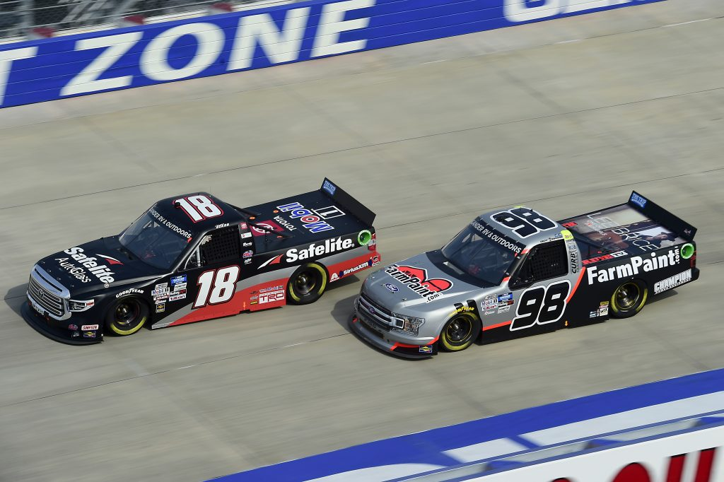 DOVER, DELAWARE - AUGUST 21: Christian Eckes, driver of the #18 Safelite AutoGlass Toyota, and Grant Enfinger, driver of the #98 Farm Paint/Curb Records Ford, race during the NASCAR Gander RV & Outdoors Truck Series KDI Office Technology 200 at Dover International Speedway on August 21, 2020 in Dover, Delaware. (Photo by Jared C. Tilton/Getty Images) | Getty Images