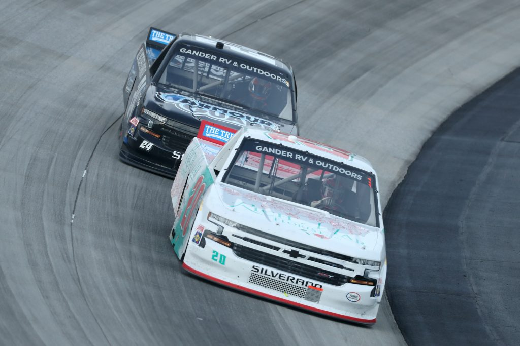 DOVER, DELAWARE - AUGUST 21: Spencer Boyd, driver of the #20 Rich Mar Florist Chevrolet, leads Sam Mayer, driver of the #24 All Weather Armour Chevrolet, during the NASCAR Gander RV & Outdoors Truck Series KDI Office Technology 200 at Dover International Speedway on August 21, 2020 in Dover, Delaware. (Photo by Hunter Martin/Getty Images) | Getty Images