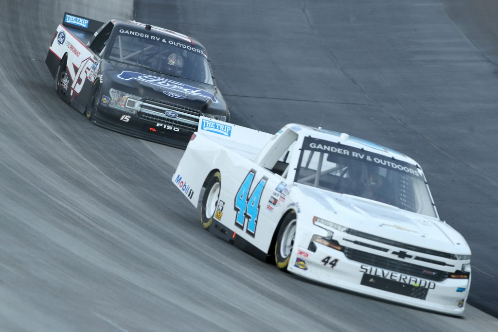 DOVER, DELAWARE - AUGUST 21: Bayley Currey, driver of the #44 Niece Chevrolet, races Tanner Gray, driver of the #15 Ford/Ford Performance Ford, during the NASCAR Gander RV & Outdoors Truck Series KDI Office Technology 200 at Dover International Speedway on August 21, 2020 in Dover, Delaware. (Photo by Hunter Martin/Getty Images) | Getty Images
