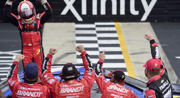 DOVER, DELAWARE - AUGUST 22: Justin Allgaier, driver of the #7 FFA Chevrolet, and crew celebrate after winning the NASCAR Xfinity Series Drydene 200 at Dover International Speedway on August 22, 2020 in Dover, Delaware. (Photo by Jared C. Tilton/Getty Images)   Getty Images