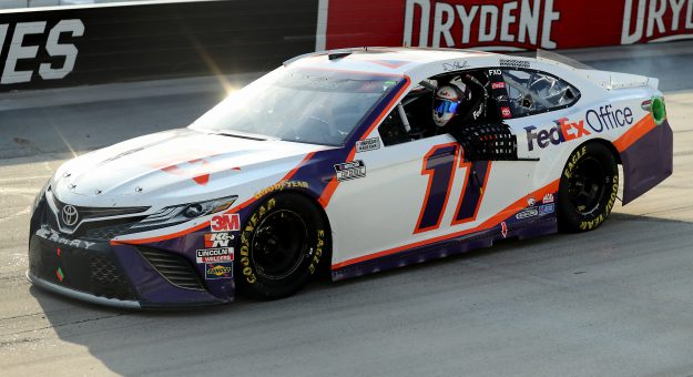 DOVER, DELAWARE - AUGUST 22: Denny Hamlin, driver of the #11 FedEx Office Toyota, celebrates after winning the NASCAR Cup Series Drydene 311 at Dover International Speedway on August 22, 2020 in Dover, Delaware. (Photo by Hunter Martin/Getty Images) | Getty Images