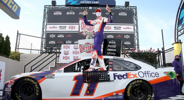 DOVER, DELAWARE - AUGUST 22: Denny Hamlin, driver of the #11 FedEx Office Toyota, celebrates in Victory Lane after winning the NASCAR Cup Series Drydene 311 at Dover International Speedway on August 22, 2020 in Dover, Delaware. (Photo by Jared C. Tilton/Getty Images) | Getty Images