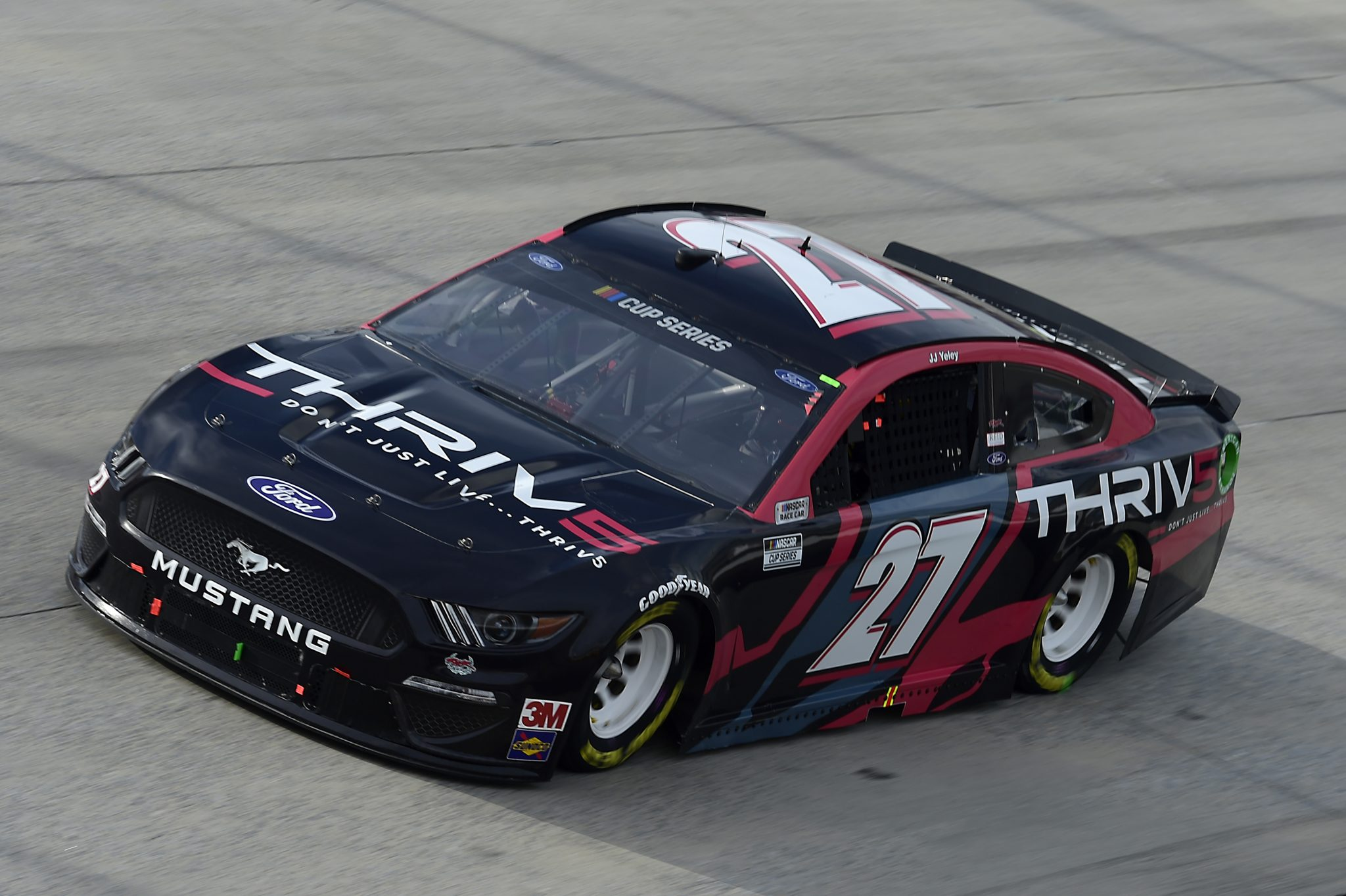 DOVER, DELAWARE - AUGUST 22: JJ Yeley, driver of the #27 Thriv5 Ford, drives drives during the NASCAR Cup Series Drydene 311 at Dover International Speedway on August 22, 2020 in Dover, Delaware. (Photo by Jared C. Tilton/Getty Images) | Getty Images