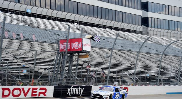 DOVER, DELAWARE - AUGUST 23: Chase Briscoe, driver of the #98 Highpoint.com Ford, crosses the finish line to win  the NASCAR Xfinity Series Drydene 200 at Dover International Speedway on August 23, 2020 in Dover, Delaware. (Photo by Jared C. Tilton/Getty Images) | Getty Images