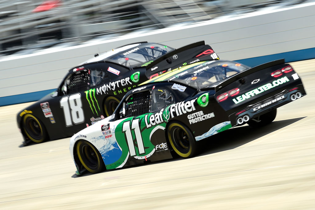 DOVER, DELAWARE - AUGUST 23: Justin Haley, driver of the #11 LeafFilter Gutter Protection Chevrolet, and Riley Herbst, driver of the #18 Monster Energy Toyota, race during the NASCAR Xfinity Series Drydene 200 at Dover International Speedway on August 23, 2020 in Dover, Delaware. (Photo by Jared C. Tilton/Getty Images) | Getty Images