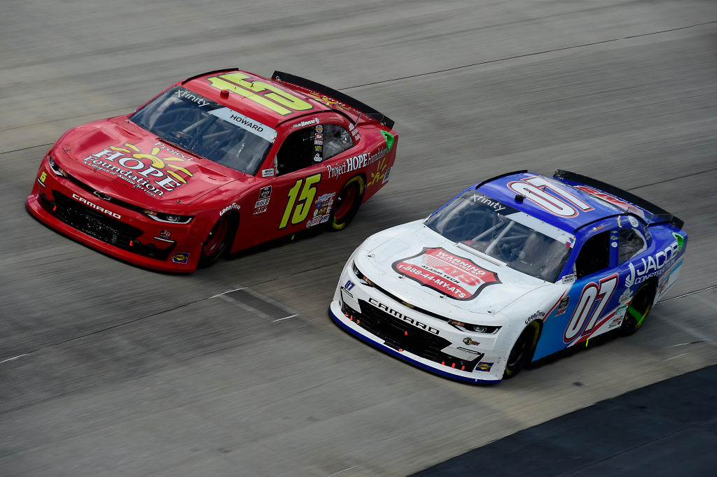 DOVER, DELAWARE - AUGUST 23: David Starr, driver of the #07 Jacob Construction Chevrolet, and Colby Howard, driver of the #15 Project Hope Foundation Chevrolet, race during the NASCAR Xfinity Series Drydene 200 at Dover International Speedway on August 23, 2020 in Dover, Delaware. (Photo by Jared C. Tilton/Getty Images) | Getty Images