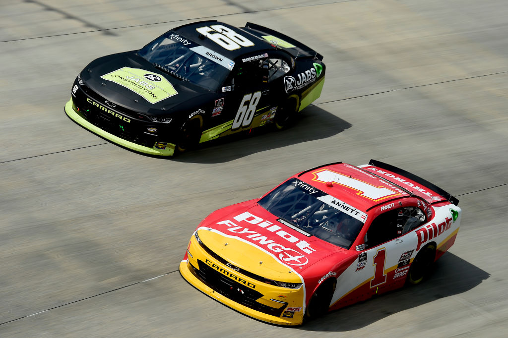 DOVER, DELAWARE - AUGUST 23: Michael Annett, driver of the #1 Pilot/Flying J Chevrolet, and Brandon Brown, driver of the #68 Jabs Construction Chevrolet, race during the NASCAR Xfinity Series Drydene 200 at Dover International Speedway on August 23, 2020 in Dover, Delaware. (Photo by Jared C. Tilton/Getty Images) | Getty Images
