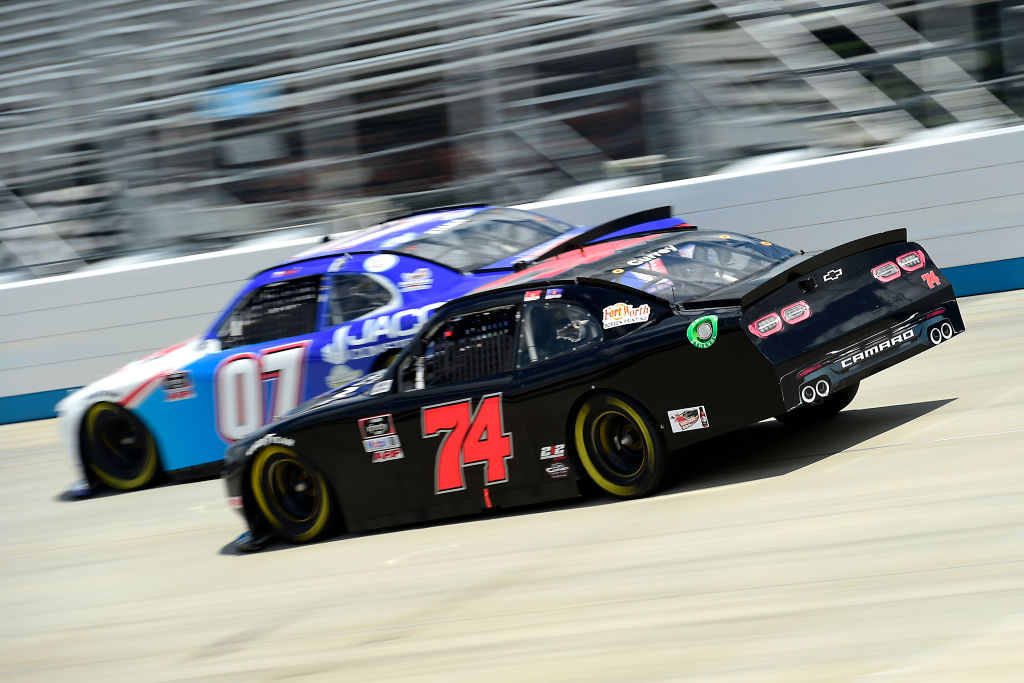 DOVER, DELAWARE - AUGUST 23: Bayley Currey, driver of the #74 Chevrolet, and David Starr, driver of the #07 Jacob Construction Chevrolet, race during the NASCAR Xfinity Series Drydene 200 at Dover International Speedway on August 23, 2020 in Dover, Delaware. (Photo by Jared C. Tilton/Getty Images) | Getty Images