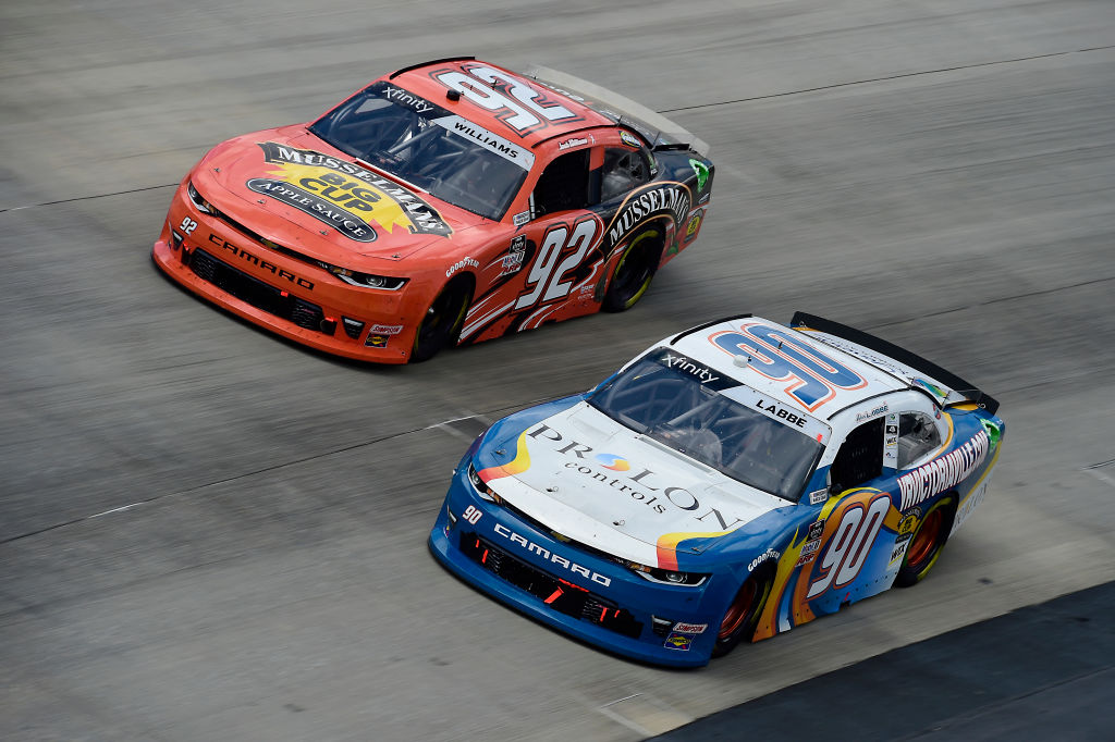 DOVER, DELAWARE - AUGUST 23: Alex Labbe, driver of the #90 Prolon/VRVictoriaVille.com Chevrolet, and Josh Williams, driver of the #92 Musselman's Big Cup Applesauce Chevrolet, race during the NASCAR Xfinity Series Drydene 200 at Dover International Speedway on August 23, 2020 in Dover, Delaware. (Photo by Jared C. Tilton/Getty Images)   Getty Images