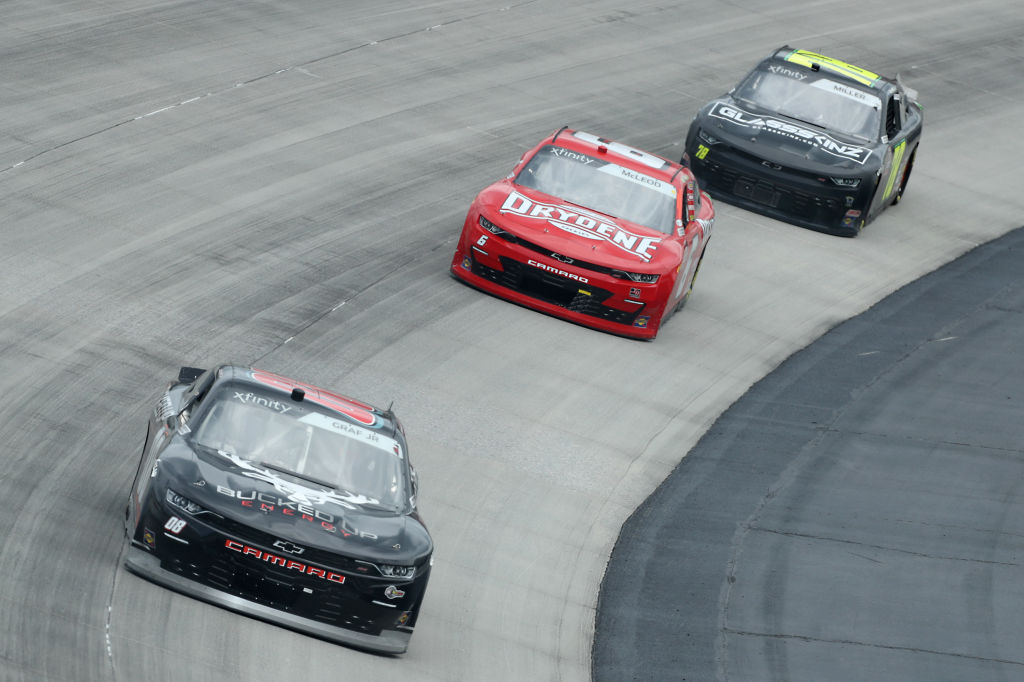 DOVER, DELAWARE - AUGUST 22: Joe Graf Jr, driver of the #08 Bucked Up Energy Chevrolet, leads BJ McLeod, driver of the #6 Drydene Chevrolet, and Vinnie Miller, driver of the #78 Glassskinz Chevrolet, during the NASCAR Xfinity Series Drydene 200 at Dover International Speedway on August 22, 2020 in Dover, Delaware. (Photo by Hunter Martin/Getty Images) | Getty Images