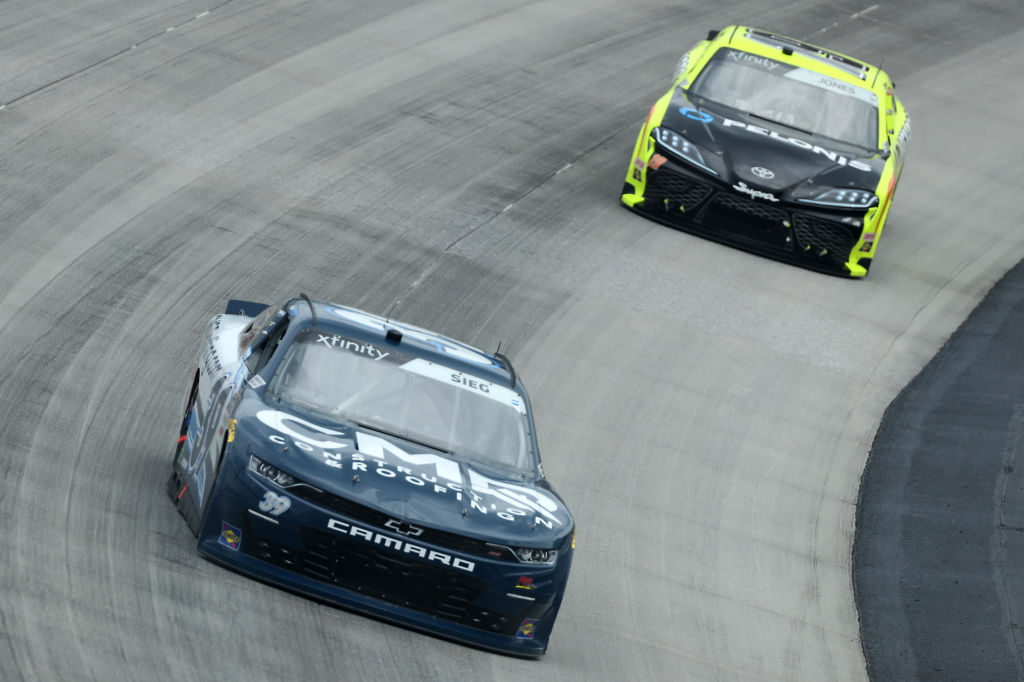 DOVER, DELAWARE - AUGUST 22: Ryan Sieg, driver of the #39 CMRRoofing.com Chevrolet, and Brandon Jones, driver of the #19 Menards/Pelonis Toyota, race during the NASCAR Xfinity Series Drydene 200 at Dover International Speedway on August 22, 2020 in Dover, Delaware. (Photo by Hunter Martin/Getty Images) | Getty Images