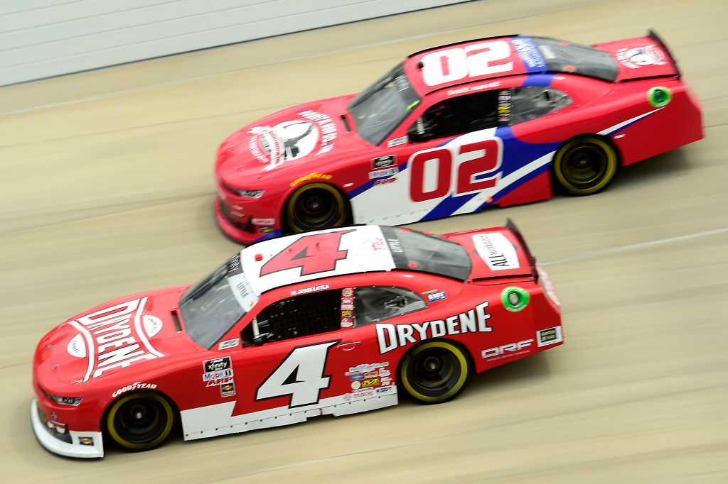 DOVER, DELAWARE - AUGUST 22: Jesse Little, driver of the #4 Drydene Chevrolet, and Brett Moffitt, driver of the #02 Robert B Our Inc Chevrolet, race during the NASCAR Xfinity Series Drydene 200 at Dover International Speedway on August 22, 2020 in Dover, Delaware. (Photo by Jared C. Tilton/Getty Images)   Getty Images