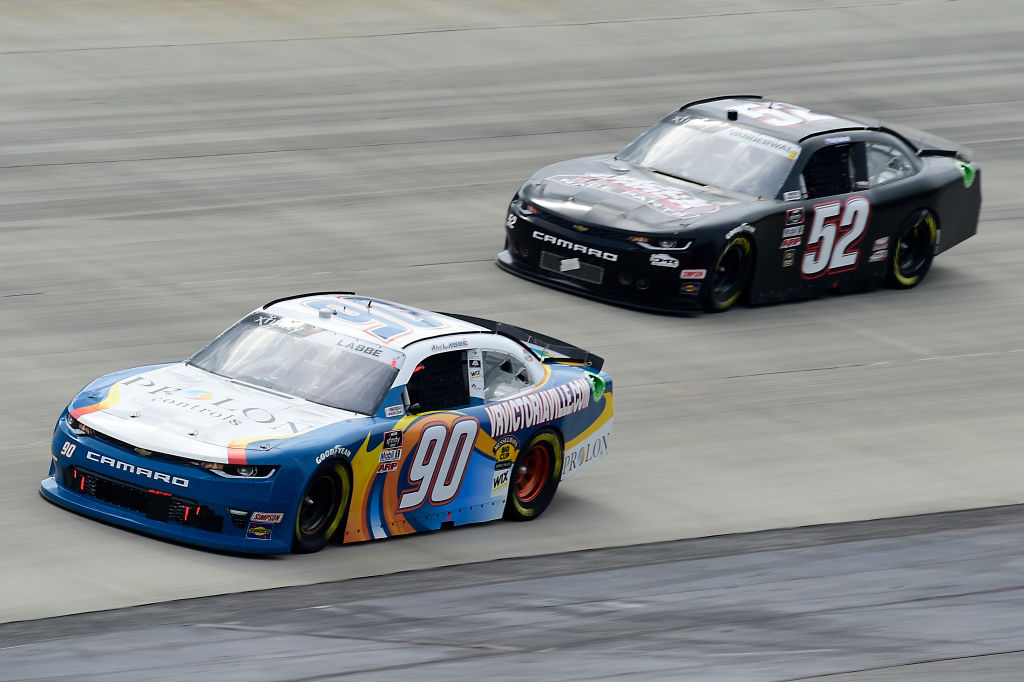 DOVER, DELAWARE - AUGUST 22: Alex Labbe, driver of the #90 Prolon/VRVictoriaVille.com Chevrolet, and Kody Vanderwal, driver of the #52 ADVANCED DAIRY SERVICES Chevrolet, race during the NASCAR Xfinity Series Drydene 200 at Dover International Speedway on August 22, 2020 in Dover, Delaware. (Photo by Jared C. Tilton/Getty Images) | Getty Images