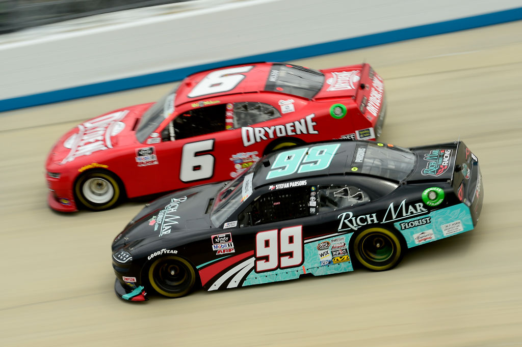 DOVER, DELAWARE - AUGUST 22: Stefan Parsons, driver of the #99 Rich Mar Florist Toyota, and BJ McLeod, driver of the #6 Drydene Chevrolet, race during the NASCAR Xfinity Series Drydene 200 at Dover International Speedway on August 22, 2020 in Dover, Delaware. (Photo by Jared C. Tilton/Getty Images) | Getty Images