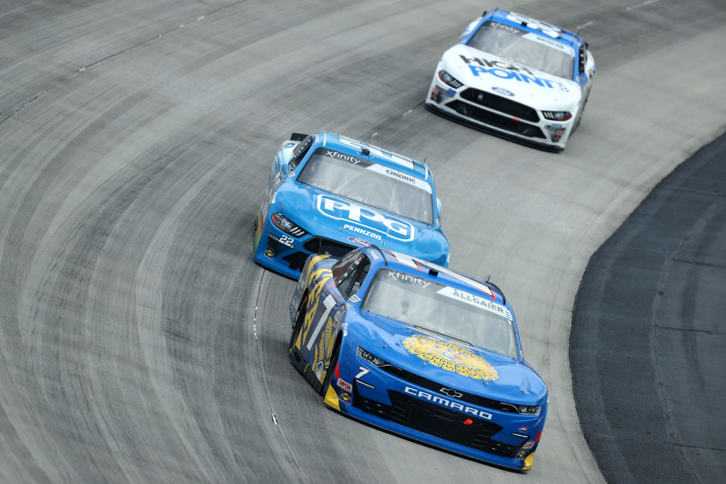 DOVER, DELAWARE - AUGUST 22: Justin Allgaier, driver of the #7 FFA Chevrolet, leads Austin Cindric, driver of the #22 PPG Ford, and Chase Briscoe, driver of the #98 Highpoint.com Ford, during the NASCAR Xfinity Series Drydene 200 at Dover International Speedway on August 22, 2020 in Dover, Delaware. (Photo by Hunter Martin/Getty Images) | Getty Images