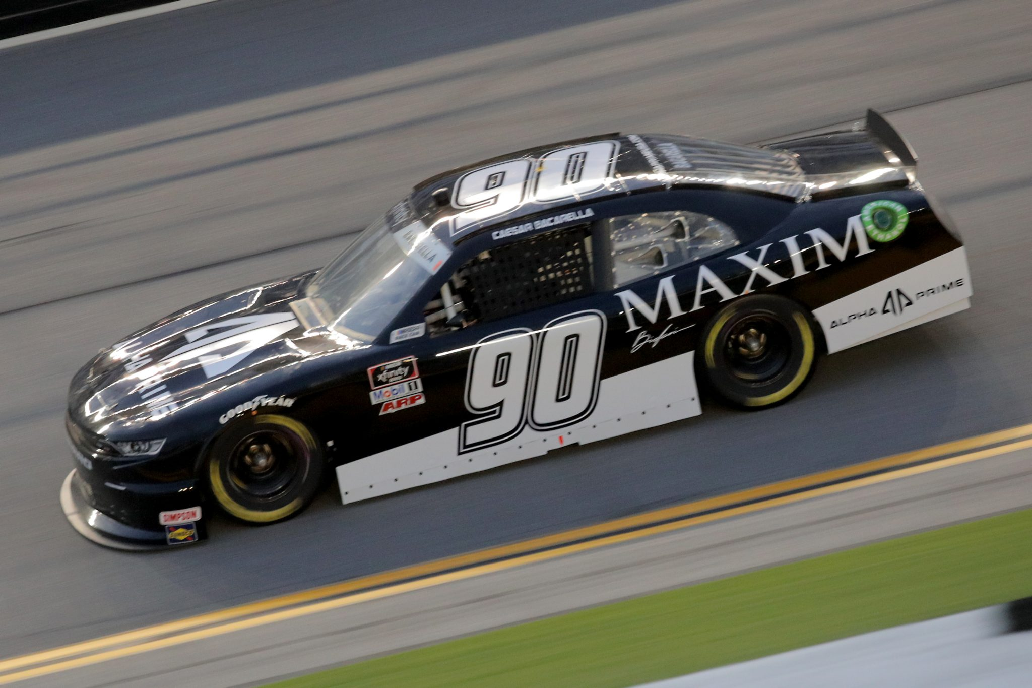 DAYTONA BEACH, FLORIDA - AUGUST 28: Caesar Bacarella, driver of the #90 Alpha Prime/Maxim Chevrolet, drives during the NASCAR Xfinity Series Wawa 250 Powered by Coca-Cola at Daytona International Speedway on August 28, 2020 in Daytona Beach, Florida. (Photo by Chris Graythen/Getty Images) | Getty Images
