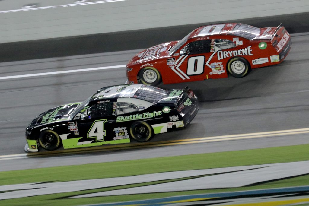 DAYTONA BEACH, FLORIDA - AUGUST 28: Jesse Little, driver of the #4 Skuttletight Chevrolet, and Jeffrey Earnhardt, driver of the #0 TeamJDMotorsports.com Chevrolet, race during the NASCAR Xfinity Series Wawa 250 Powered by Coca-Cola at Daytona International Speedway on August 28, 2020 in Daytona Beach, Florida. (Photo by Chris Graythen/Getty Images) | Getty Images