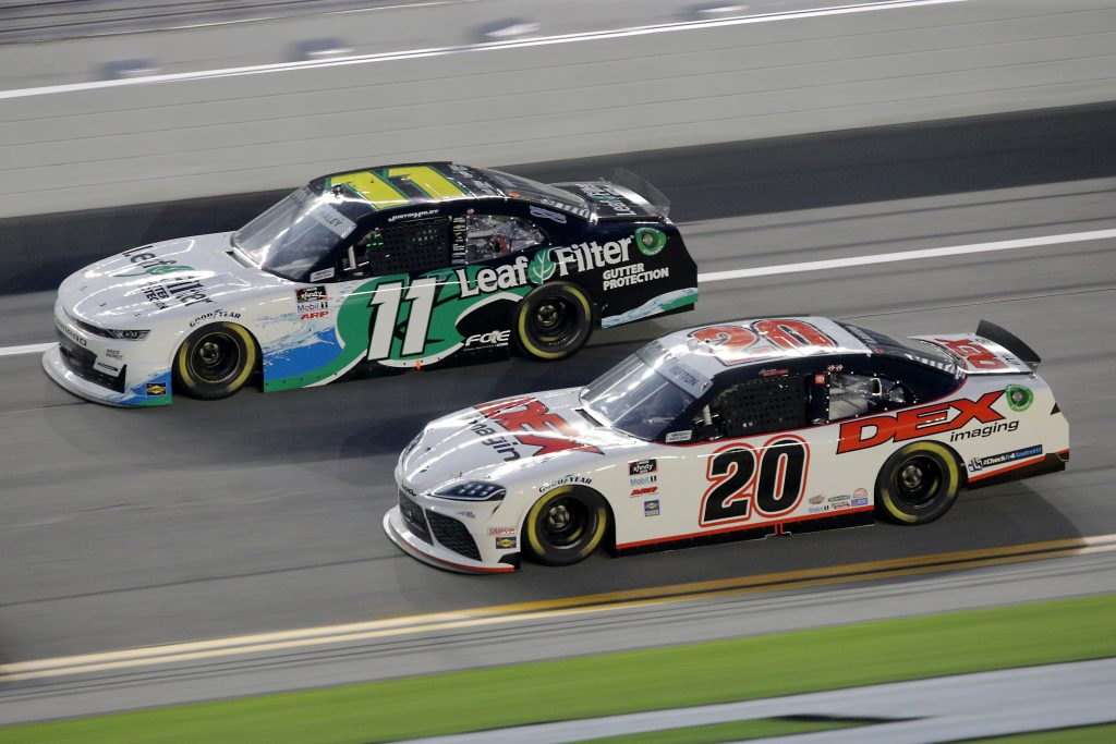DAYTONA BEACH, FLORIDA - AUGUST 28: Justin Haley, driver of the #11 LeafFilter Gutter Protection Chevrolet, and Harrison Burton, driver of the #20 DEX Imaging Toyota, race during the NASCAR Xfinity Series Wawa 250 Powered by Coca-Cola at Daytona International Speedway on August 28, 2020 in Daytona Beach, Florida. (Photo by Chris Graythen/Getty Images) | Getty Images
