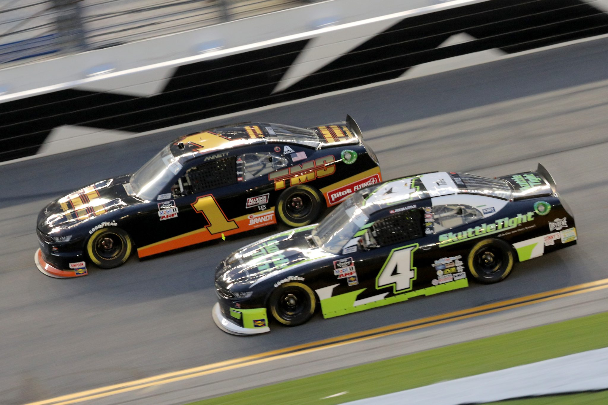 DAYTONA BEACH, FLORIDA - AUGUST 28: Michael Annett, driver of the #1 TMC Chevrolet, and Jesse Little, driver of the #4 Skuttletight Chevrolet, race during the NASCAR Xfinity Series Wawa 250 Powered by Coca-Cola at Daytona International Speedway on August 28, 2020 in Daytona Beach, Florida. (Photo by Chris Graythen/Getty Images) | Getty Images
