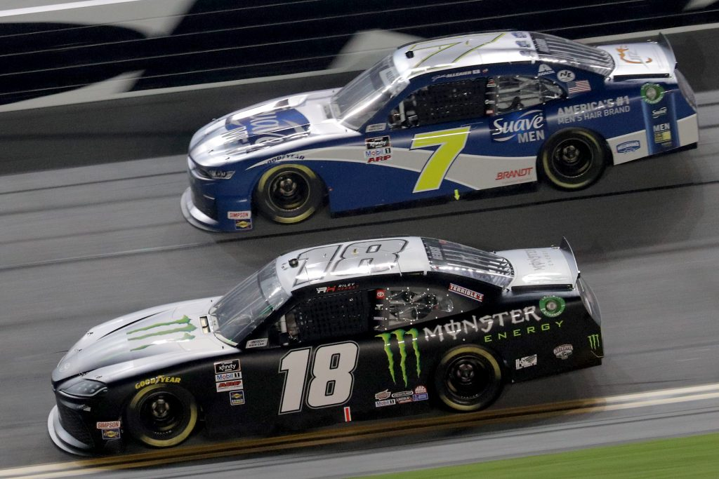 DAYTONA BEACH, FLORIDA - AUGUST 28: Riley Herbst, driver of the #18 Monster Energy Toyota, and Justin Allgaier, driver of the #7 Suave Men Chevrolet, race during the NASCAR Xfinity Series Wawa 250 Powered by Coca-Cola at Daytona International Speedway on August 28, 2020 in Daytona Beach, Florida. (Photo by Chris Graythen/Getty Images) | Getty Images