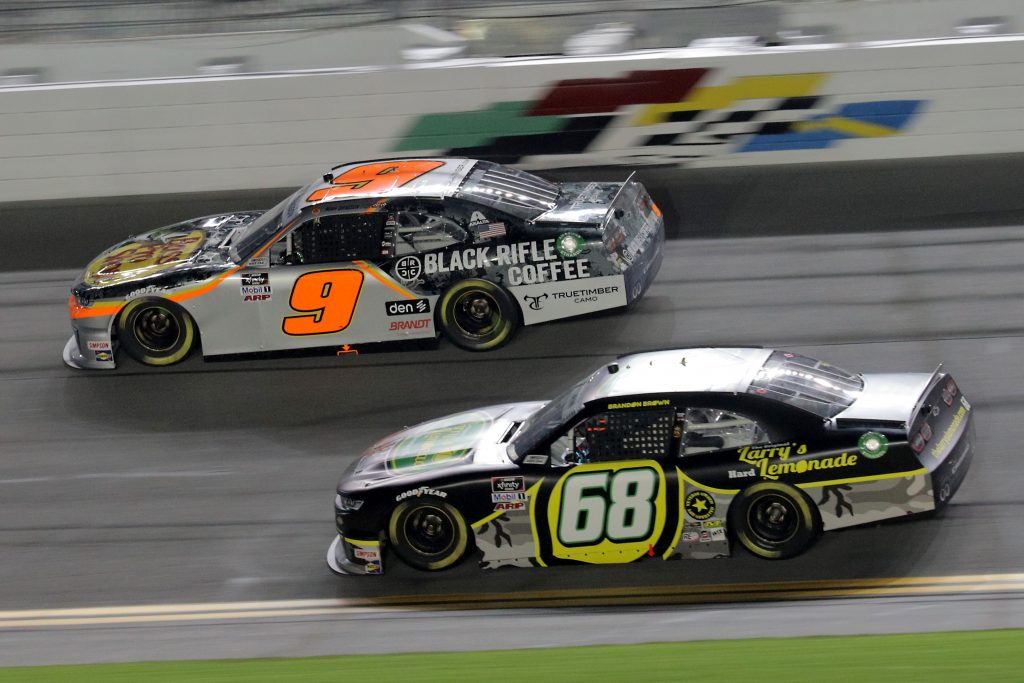 DAYTONA BEACH, FLORIDA - AUGUST 28: Noah Gragson, driver of the #9 Bass Pro Shops.TrueTimber Camo Chevrolet, and Brandon Brown, driver of the #68 Original Larry's Hard Lemonade Chevrolet, race during the NASCAR Xfinity Series Wawa 250 Powered by Coca-Cola at Daytona International Speedway on August 28, 2020 in Daytona Beach, Florida. (Photo by Chris Graythen/Getty Images) | Getty Images