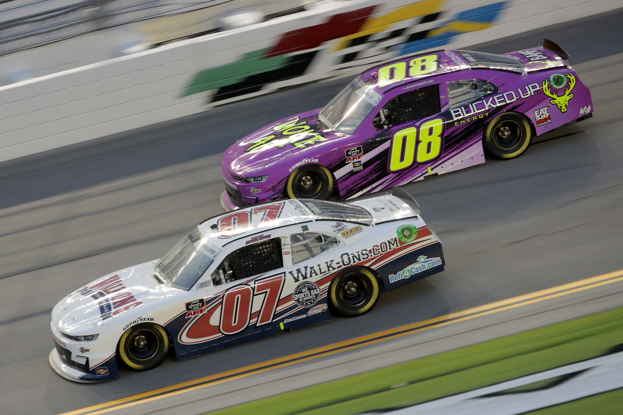 DAYTONA BEACH, FLORIDA - AUGUST 28: Gray Gaulding, driver of the #07 Chevrolet, and Joe Graf Jr., driver of the #08 Bucked Up Chevrolet, race during the NASCAR Xfinity Series Wawa 250 Powered by Coca-Cola at Daytona International Speedway on August 28, 2020 in Daytona Beach, Florida. (Photo by Chris Graythen/Getty Images) | Getty Images