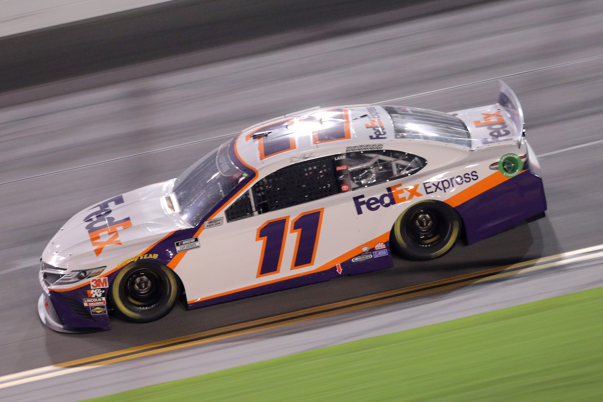 DAYTONA BEACH, FLORIDA - AUGUST 29: Denny Hamlin, driver of the #11 FedEx Express Toyota, races during the NASCAR Cup Series Coke Zero Sugar 400 at Daytona International Speedway on August 29, 2020 in Daytona Beach, Florida. (Photo by Chris Graythen/Getty Images) | Getty Images