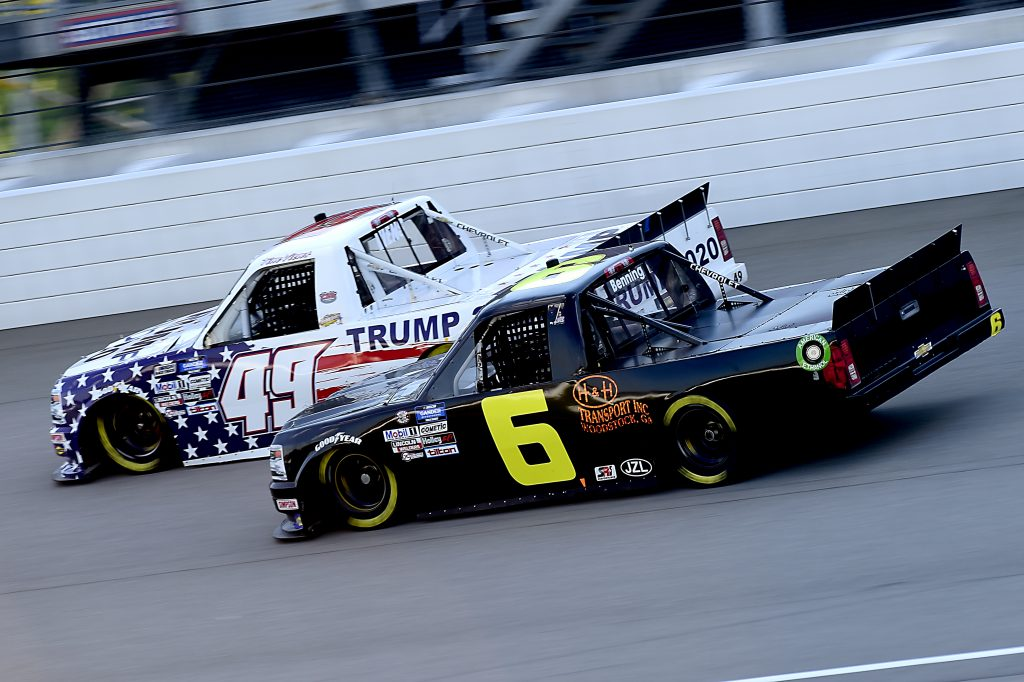 BROOKLYN, MICHIGAN - AUGUST 07: Tim Viens, driver of the #49 CMI Motorsports Chevrolet, races Norm Benning, driver of the #6 H&H Transport Chevrolet, during the NASCAR Gander RV & Outdoors Truck Series Henry Ford Health System 200 at Michigan International Speedway on August 07, 2020 in Brooklyn, Michigan. (Photo by Jared C. Tilton/Getty Images) | Getty Images