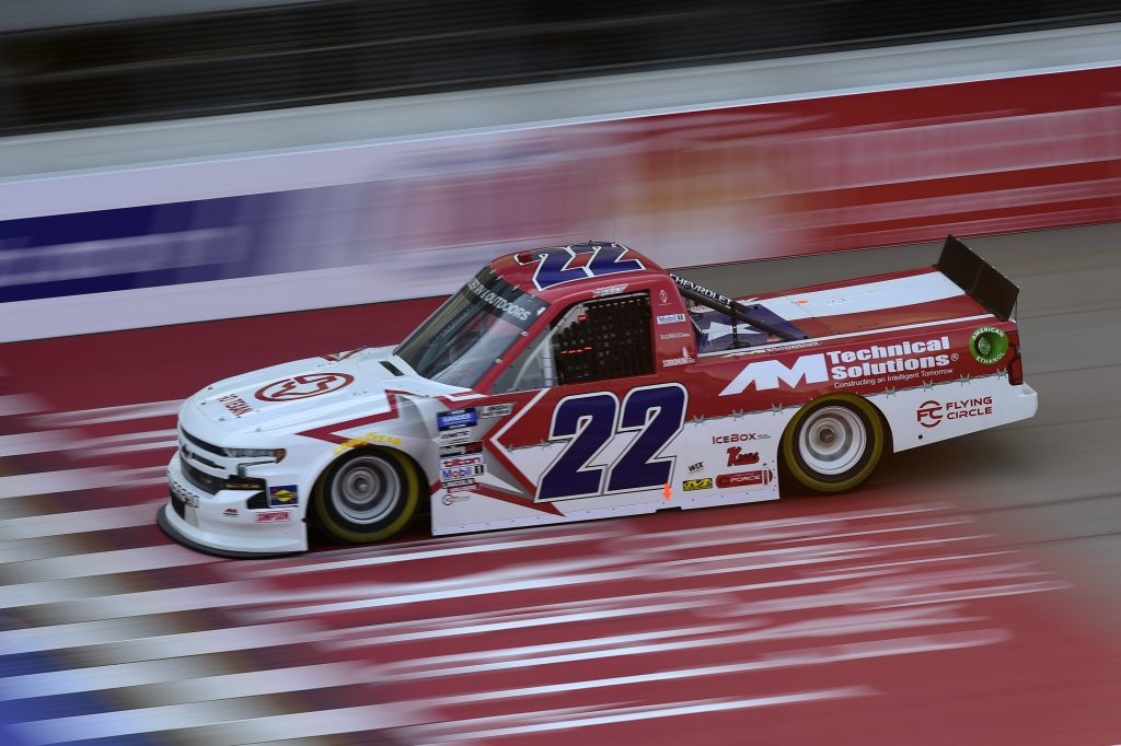 BROOKLYN, MICHIGAN - AUGUST 07: Austin Wayne Self, driver of the #22 GOTEXAN/AM Technical Solutions Chevrolet, drives during the NASCAR Gander RV & Outdoors Truck Series Henry Ford Health System 200 at Michigan International Speedway on August 07, 2020 in Brooklyn, Michigan. (Photo by Jared C. Tilton/Getty Images) | Getty Images