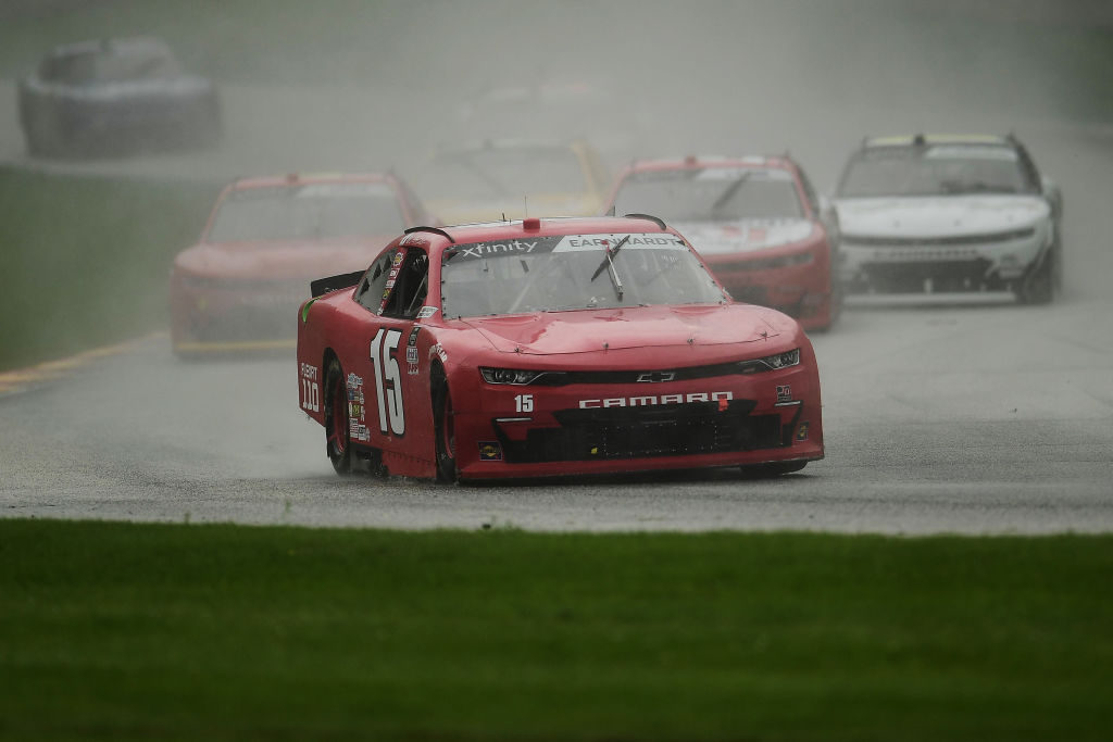 ELKHART LAKE, WISCONSIN - AUGUST 08: Jeffrey Earnhardt, driver of the #15 TeamJDMotorsports.com Chevrolet, leads a pack of cars during the NASCR Xfinity Series Henry 180 at Road America on August 08, 2020 in Elkhart Lake, Wisconsin. (Photo by Stacy Revere/Getty Images) | Getty Images