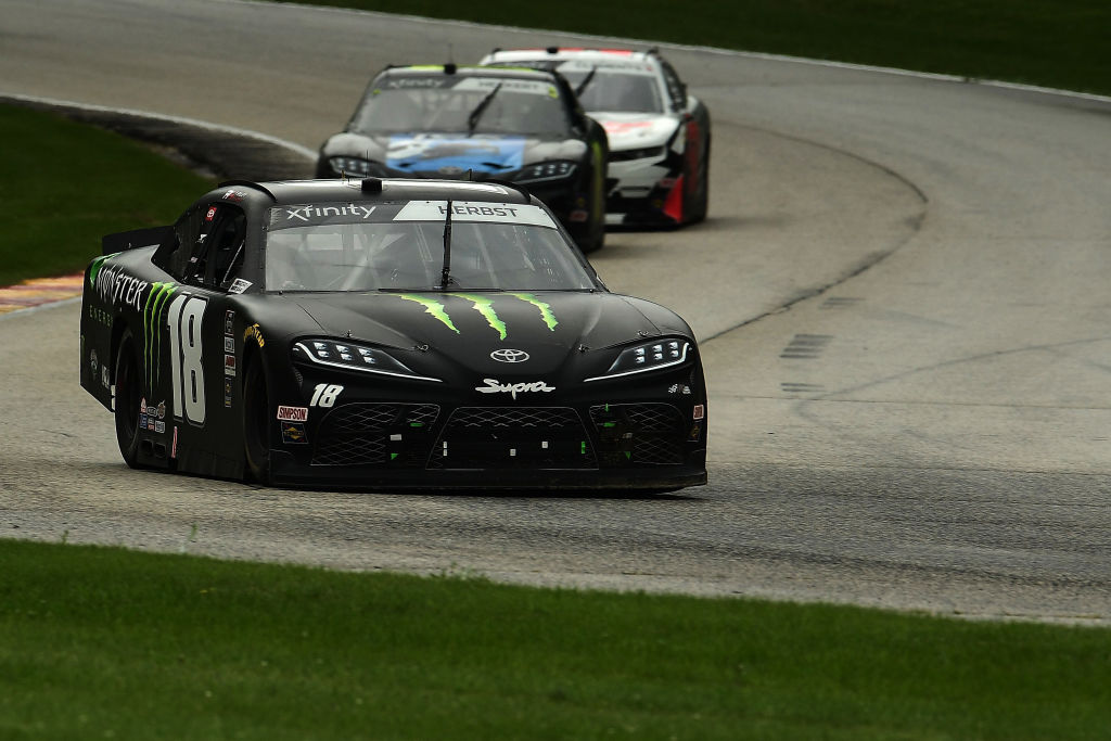 ELKHART LAKE, WISCONSIN - AUGUST 08: Riley Herbst, driver of the #18 Monster Energy Toyota, leads a pack of cars during the NASCR Xfinity Series Henry 180 at Road America on August 08, 2020 in Elkhart Lake, Wisconsin. (Photo by Stacy Revere/Getty Images) | Getty Images