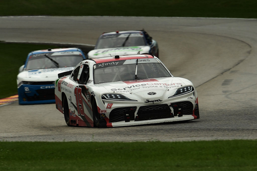 ELKHART LAKE, WISCONSIN - AUGUST 08: Brandon Jones, driver of the #19 Toyota Service Center Toyota, leads a pack of cars during the NASCR Xfinity Series Henry 180 at Road America on August 08, 2020 in Elkhart Lake, Wisconsin. (Photo by Stacy Revere/Getty Images) | Getty Images