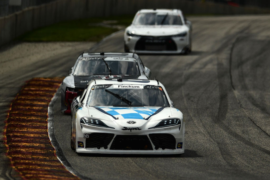ELKHART LAKE, WISCONSIN - AUGUST 08: Chad Finchum, driver of the #66 OCR GAZ BAR Toyota, leads a pack of cars during the NASCAR Xfinity Series Henry 180 at Road America on August 08, 2020 in Elkhart Lake, Wisconsin. (Photo by Stacy Revere/Getty Images) | Getty Images