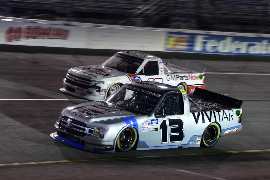 RICHMOND, VIRGINIA - SEPTEMBER 10: Johnny Sauter, driver of the #13 Vivitar Ford, and Carson Hocevar, driver of the #40 Scott's Chevrolet, race during the NASCAR Gander Outdoors Truck Series ToyotaCare 250 at Richmond Raceway on September 10, 2020 in Richmond, Virginia. (Photo by Jared C. Tilton/Getty Images) | Getty Images