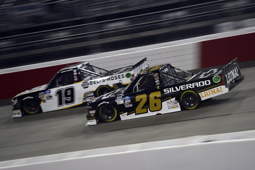 RICHMOND, VIRGINIA - SEPTEMBER 10: Tyler Ankrum, driver of the #26 Chevy Silverado Chevrolet, and Derek Kraus, driver of the #19 Gates Hydraulics/NAPA Belts & Hoses Toyota, race during the NASCAR Gander Outdoors Truck Series ToyotaCare 250 at Richmond Raceway on September 10, 2020 in Richmond, Virginia. (Photo by Jared C. Tilton/Getty Images) | Getty Images