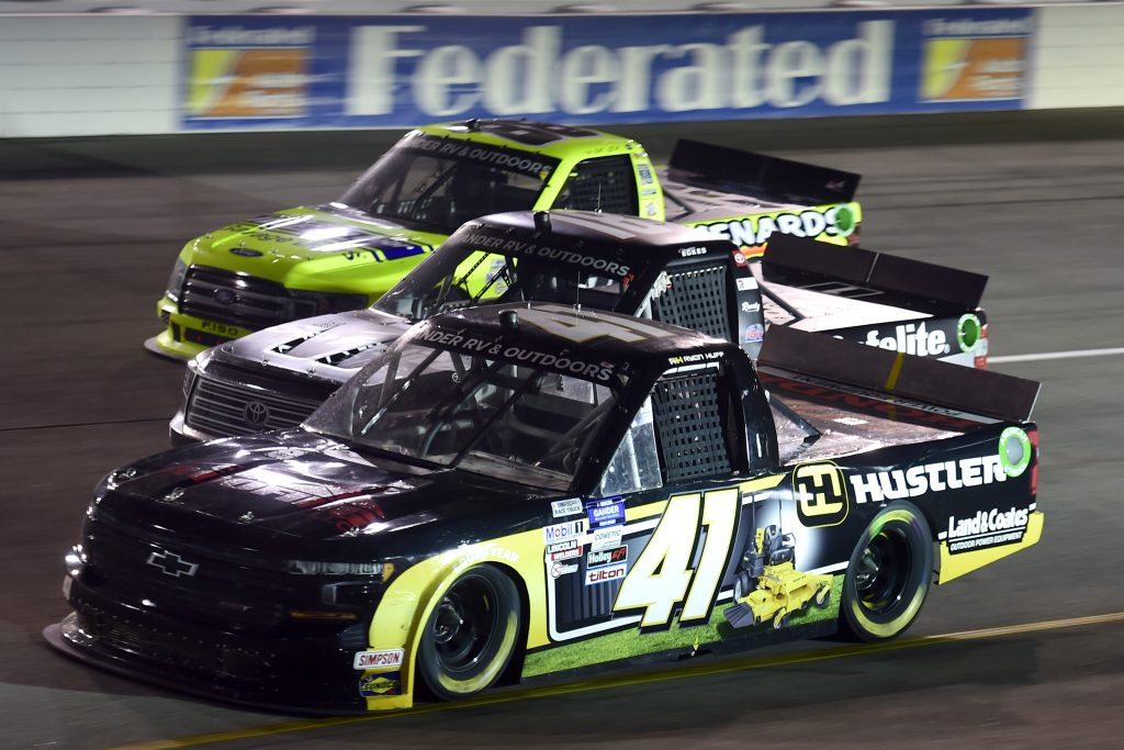 RICHMOND, VIRGINIA - SEPTEMBER 10: Ryan Huff, driver of the #41 Hustler/Land & Coats Chevrolet, Christian Eckes, driver of the #18 Safelite AutoGlass Toyota, and Matt Crafton, driver of the #88 Ideal Door/Menards Ford, race during the NASCAR Gander Outdoors Truck Series ToyotaCare 250 at Richmond Raceway on September 10, 2020 in Richmond, Virginia. (Photo by Jared C. Tilton/Getty Images)   Getty Images