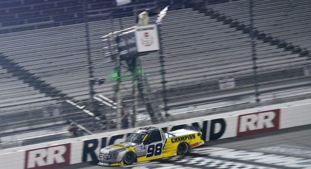 RICHMOND, VIRGINIA - SEPTEMBER 10: Grant Enfinger, driver of the #98 Champion/Curb Records Ford, crosses the finish line to win the NASCAR Gander Outdoors Truck Series ToyotaCare 250 at Richmond Raceway on September 10, 2020 in Richmond, Virginia. (Photo by Jared C. Tilton/Getty Images) | Getty Images
