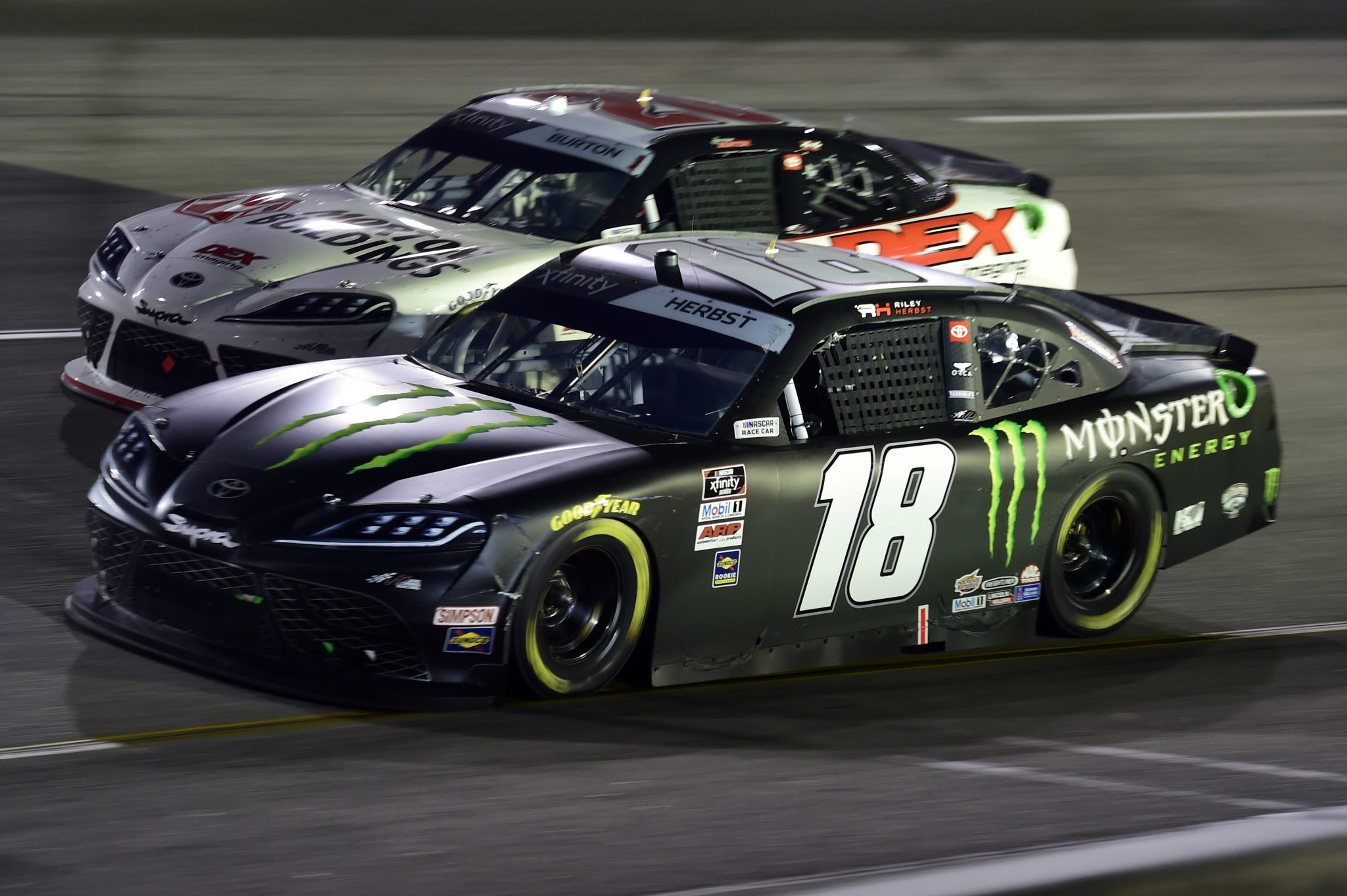 RICHMOND, VIRGINIA - SEPTEMBER 11: Riley Herbst, driver of the #18 Monster Energy Toyota, and Harrison Burton, driver of the #20 DEX Imaging Toyota, race during the NASCAR Xfinity Series Go Bowling 250 at Richmond Raceway on September 11, 2020 in Richmond, Virginia. (Photo by Jared C. Tilton/Getty Images) | Getty Images