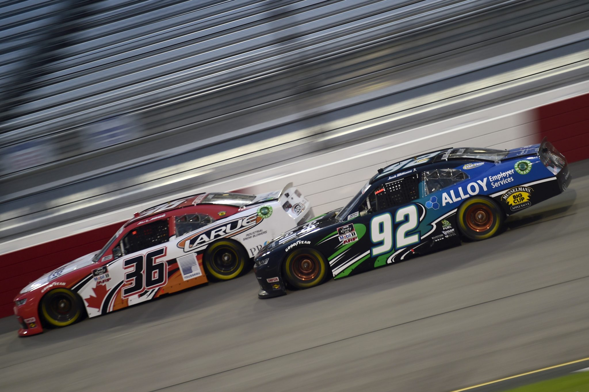 RICHMOND, VIRGINIA - SEPTEMBER 11: Josh Williams, driver of the #92 DGM Racing Chevrolet, and Alex Labbe, driver of the #36 DGM Racing Chevrolet, race during the NASCAR Xfinity Series Go Bowling 250 at Richmond Raceway on September 11, 2020 in Richmond, Virginia. (Photo by Jared C. Tilton/Getty Images) | Getty Images